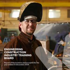 Annual report cover shows welder with mask up looking into camera