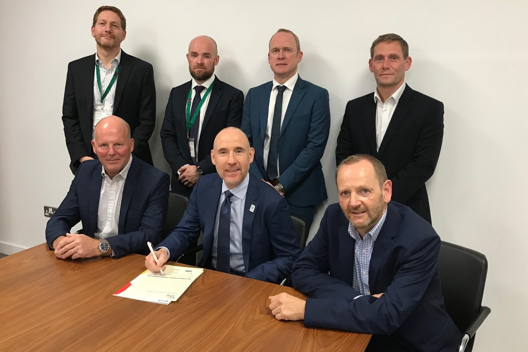 Members of the industry council sign the charter supporting connected competence