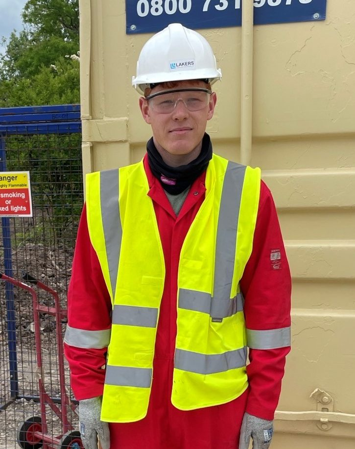 Liam McShane, apprentice pipefitter with Laker-Vent engineering stands outside container in full PPE.