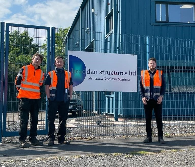 Image shows three staff members from Braddan Structures outside their premises in Darlington